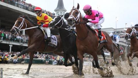 Chris Landeros aboard Bodexpress (left) races Luis Saez aboard Maximum Security (right) during the 145th running of the Kentucky Derby at Churchill Downs.