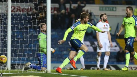 Sam Winnall celebrates his first goal against Leeds United