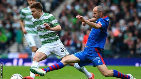 James Forrest of Celtic is tackled by David Raven of Inverness Caledonian Thistle