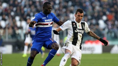 Omar Colley in action for Sampdoria against Mario Mandzukic of Juventus