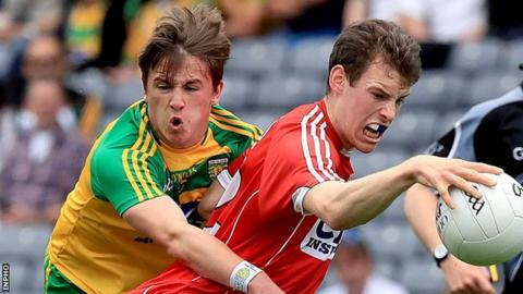 Donegal's Peadar Mogan challenges Cork's Cathal Maguire