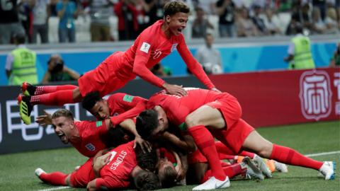 England's players celebrate scoring against Tunisia