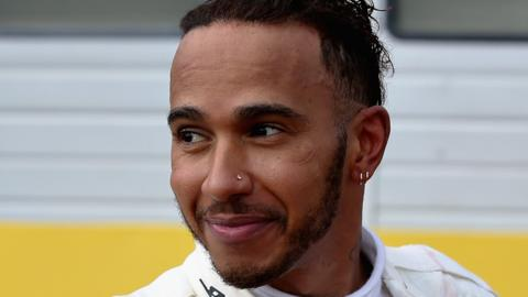 Lewis Hamilton celebrates winning the French Grand Prix