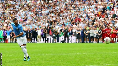 Ilkay Gundogan scores a penalty against Liverpool in the Community Shield