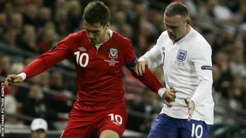 Aaron Ramsey and England's Wayne Rooney