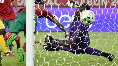 Togo goalkeeper Kossi Agassa watches as the ball goes past him for Morocco's second goal