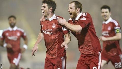 Mark Reynolds, right, congratulates Ryan Christie after his wonder goal in the 7-2 win over Motherwell