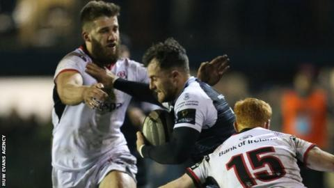 Luke Morgan of Ospreys takes on Ulster's Stuart McCloskey and Peter Nelson