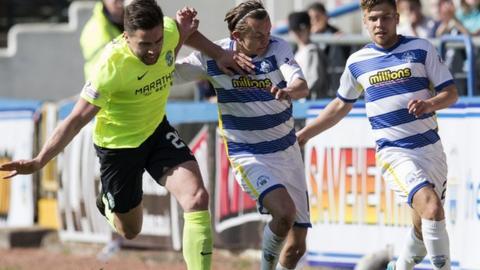 Darren McGregor and Aiden Nesbitt battle for the ball