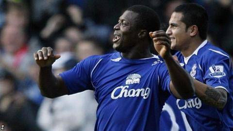 Yakubu celebrates with Everton team-mate Tim Cahill after scoring against his former club Middlesbrough at Goodison Park in November 2008