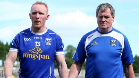 Hyland walks to the dressing room with Cian Mackey after Cavan's qualifier defeat by Derry last month