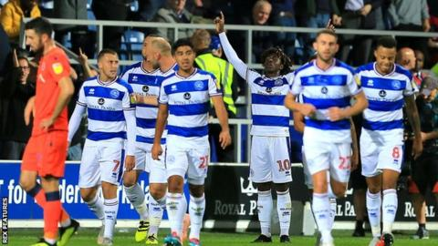 Ebere Eze (third from right) celebrates his goal for QPR against Millwall
