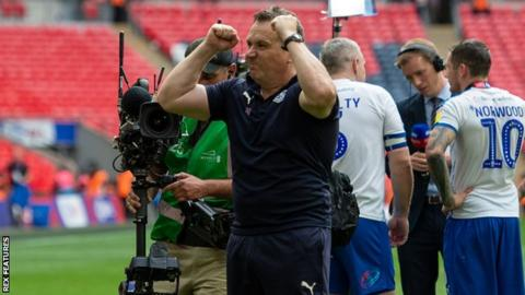 Tranmere boss Micky Mellon celebrates promotion to League One