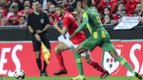 Benfica midfielder Adel Taarabt (centre) in action