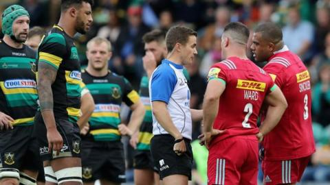 Referee Luke Pearce discusses the alleged eye gouging on Northampton's Michael Paterson with Harlequins captain Dave Ward and Kyle Sinckler