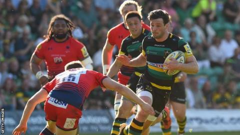 Ben Foden of Northampton Saints is tackled by Chris Pennell of Worcester Warriors