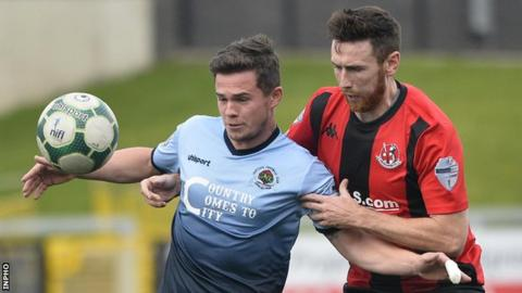 Michael McCrudden and Howard Beverland in action during Crusaders' 4-1 win over Institute at the Brandywell in September