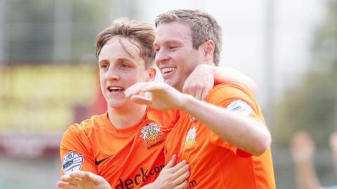 Joel Cooper celebrates his first goal for Glenavon with team-mate Kevin Braniff in the 3-0 win at Warrenpoint Town