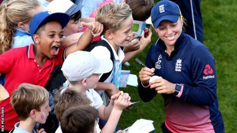 Children watching cricket