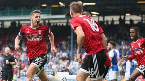 Tom Cairney celebrates his goal with Fulham teammates