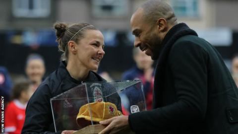 Loren Dykes receives a special 100th cap from Danny Gabbidon