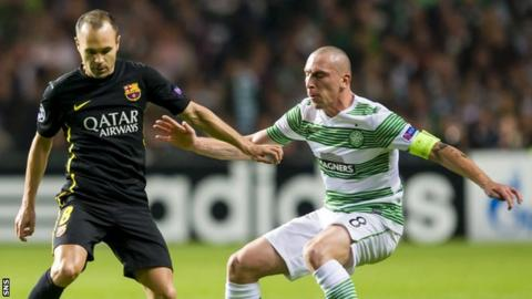 Celtic's Scott Brown closes down Andres Iniesta of Barcelona during their Champions League match in Glasgow in October 2013