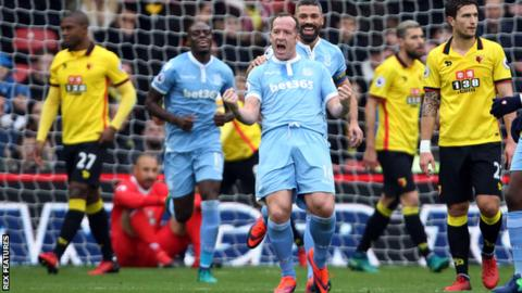Charlie Adam celebrates after Stoke City take the lead at Watford