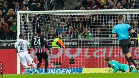Marcus Thuram scoring Borussia Moenchengladbach's first goal against Eintracht Frankfurt.