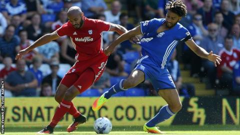 Frederic Gounongbe clashes with Birmingham City's Ryan Shotton
