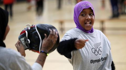 AUCKLAND, NEW ZEALAND - JUNE 19: Hibo Musa tries karate during the Olympic Refugee Sport Day at The Trusts Arena on June 19, 2018 in Auckland, New Zealand. The event saw refugees aged between 11 and 18 given the opportunity to get involved in sport and meet some of New Zealand's Olympic athletes at a 'have a go sports day. The day aims to aid the refugees integration into New Zealand society, with research showing sport and recreation has a significant and positive impact on refugees' well-being and development, especially among those who have recently arrived in a new country. (Photo by Fiona Goodall/Getty Images)