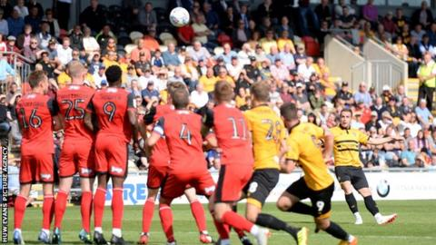 Matthew Dolan of Newport County scores from a free kick
