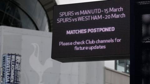 Sign displaying news of matches being postponed