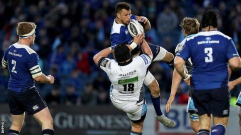 Glasgow's Zander Fagerson tackles Leinster's Zane Kirchner in mid air