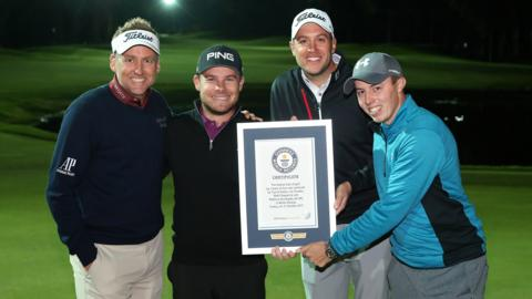 Ian Poulter, Tyrrell Hatton, Matthew Southgate and Matthew Fitzpatrick celebrate setting a new Guiness World Record for the fastest hole of golf