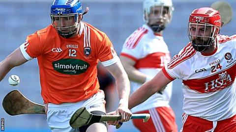 Armagh's Conor Corvan with Naoise Waldron of Derry