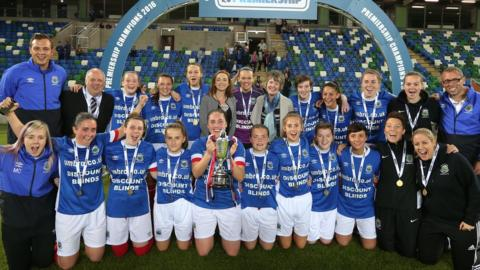 Linfield Ladies celebrate winning the Women's Premiership title after being presented with the trophy before their final game against Mid-Ulster
