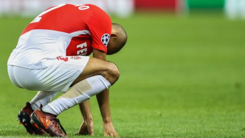 A Monaco players reacts to defeat