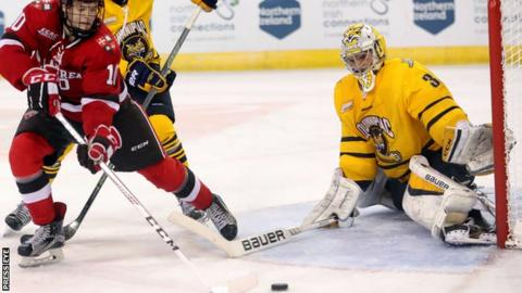 Chris Truehl keeps out St. Lawrence Saints' Ryan Lough while playing for the Quinnipiac Bobcats at the Friendship Four in Belfast