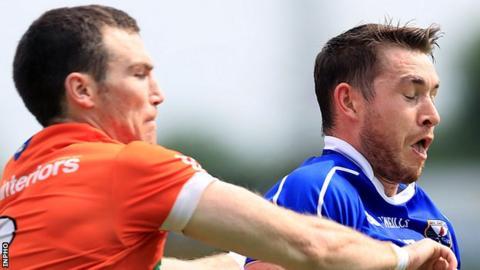 Brendan Donaghy of Armagh challenges Cavan's David Givney