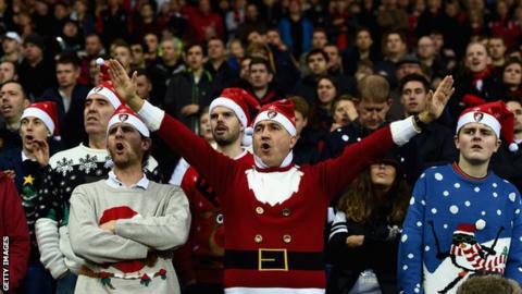 Football fans in festive wear