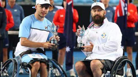 Andy Lapthorne and David Wagner with their Australian Open quad wheelchair doubles final runners-up trophies