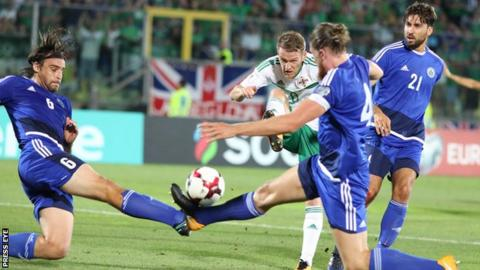Steven Davis fires through a crowded penalty area in the first half