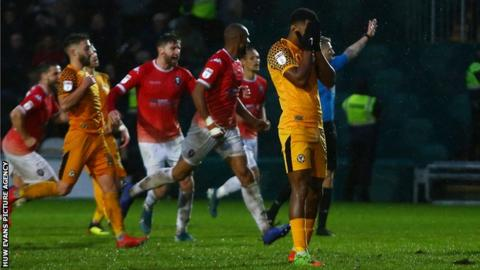 Newport County's Tristan Abrahams shows his despair after having his penalty saved