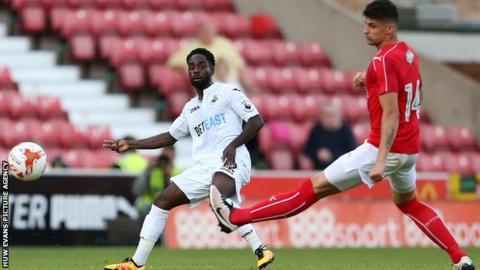 Nathan Dyer crosses the ball for Swansea City against Swindon Town