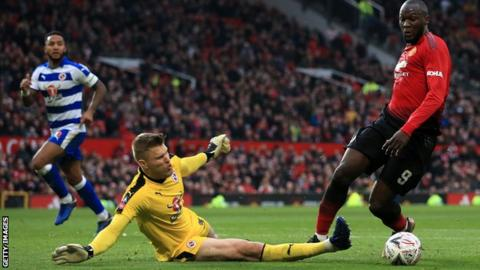 Romelu Lukaku of Man Utd goes around Reading goalkeeper Anssi Jaakkola