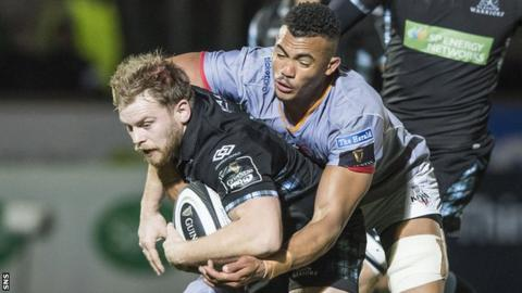 Pat MacArthur is tackled while playing for Glasgow Warriors