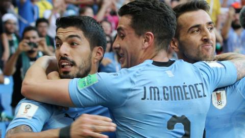 Luis Suarez celebrates scoring for Uruguay