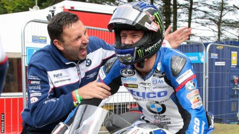Ian Hutchinson is congratulated after winning the opening Superstock race at the Ulster Grand Prix