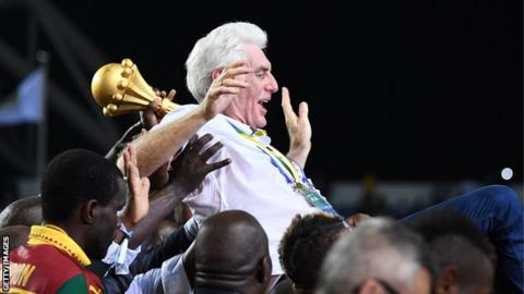 Cameroon coach Hugo Broos celebrating winning the Africa Cup of Nations