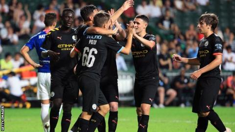 Phil Foden and Man City team-mates